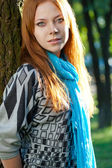 Red-haired woman near tree — Stock Photo