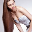 Woman with long hair looking down — Stock Photo #8395571