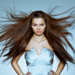 Portrait of woman with flying hair — Stock Photo
