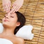 Woman recieving massage of head — Stock Photo #8962282