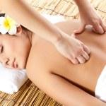 Woman receiving back massage — Stock Photo #8962397