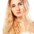 Closeup woman face with long curly hair — Stock Photo #9349793