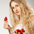 Woman holding strawberry — Stock Photo #9349848