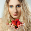 Closeup portrait of woman who holding strawberry — Stock Photo
