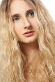 Closeup woman face with curly hair vertical — Stock fotografie