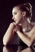 Brunette woman with jewellery — Stock Photo