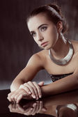 Brunette woman with silver jewellery — Stock Photo