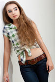 Fashion model woman wearing country style clothes — Stock Photo