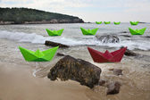 Green paper boats with one red — Stock Photo