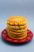 Red plate with six blueberry waffles — Стоковое фото