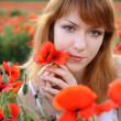 Stock Photo: Girl with poppies