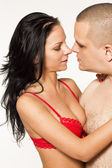 Sexy passionate heterosexual couple close to each other on white isolated background — Stock Photo