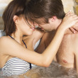 Stock Photo: Young passionate couple kissing in the jacuzzi