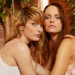 Sexy lesbian couple close to each other — Stock Photo