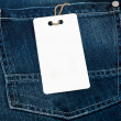 Jeans texture with empty label for your text — Stock Photo
