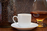 Cup of coffee and cognac — Stock Photo