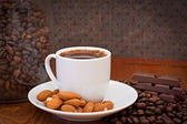 Cup of coffee, almonds and chocolate — Stok fotoğraf