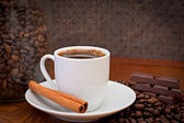 Cup of coffee, cinnamon and chocolate — Stock Photo