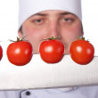 Men cook. cherry tomatoes cut into the knife — Stock Photo