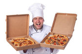 Male chef holding open two boxes of pizza — Stock Photo