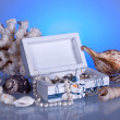 Box with seashells, coral and pearls — Stock Photo