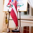 The national flag and Coat of arms of Latvia — Stock Photo
