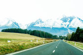 Road with panorama of High Tatra mountains — Stock Photo
