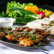 Shashlik with lavash and vegetables - Stock Photo