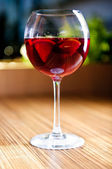 Glass of red wine with fruits — Stock Photo