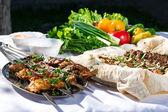 Shashlik with lavash and vegetables — Stock Photo