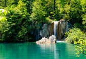 Beautiful waterfall in the Plitvice Lakes National Park in Croat — Stock Photo