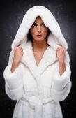Beautiful woman in white fur coat — Stock Photo