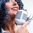 Beautiful young brunette singing - Stock Photo