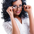 Young woman wearing glasses posing over white background — Stock Photo