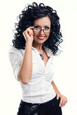 Young smiling woman wearing glasses posing over white background — Stock Photo