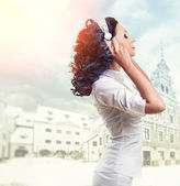 Beautiful woman listening music with headphones — Stock Photo