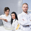 Friendly male dentist, assistant and smiling patient at dental clinic — Stock Photo #9409926