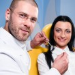 Friendly male dentist with smiling patient at dental clinic — Stock Photo