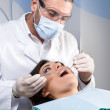 Female patient having her teeth examined by specialist — Stock Photo