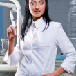 Attractive female doctor with medical syringe — Stock Photo