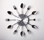 Clock design with spoons and forks — Stock Photo