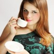 Lady holds cup - Stock Photo