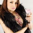 Lady in furs holds Martini — Stock Photo #10178774