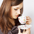 Woman drinking tea - Stock Photo