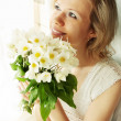 Woman with a bunch hellebore — Stock Photo