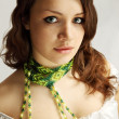 Woman in green scarf — Stock Photo