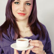 Beauty woman holds cup - Stock Photo