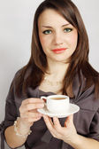 Young woman holds cup — Stock Photo