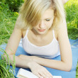 Foto Stock: Blonde reading book