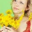 Woman and yellow bouquet — Stock Photo